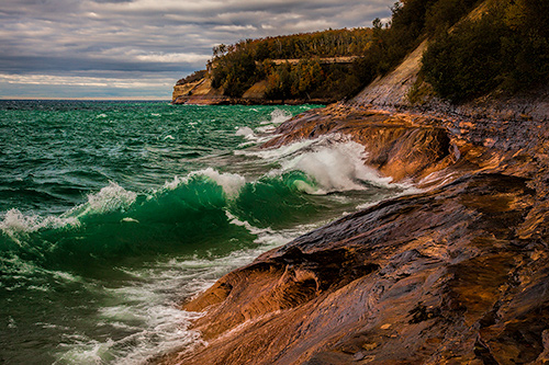 Storm surges along pictured rocks